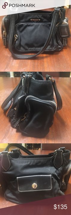 Authentic Black Prada Nylon Purse 👛!!! EUC!!! Authentic black nylon purse with two side pockets, front pocket, coin compartment on the back, inside compartment, and middle pocket. You can fit so much in here 😍. Small rip on the strap but easy repair. Bundle with the Prada sunglasses and you'll get and extra 20% of your bundle discount :) MAKE AN OFFER OFFER 😄😄❤️ Prada Bags
