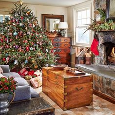 Decorating your tree this weekend? My client's antique house in CT has low ceilings in the family room, so we made up for height with this extra-fat tree.✨ Flip through @cottagesgardens holiday issue for more.  || Lisa Hilderbrand - Hilderbrand Interiors  Robert Grant for CTC&G #hilderbrandinteriors #fatchristmastree #christmasinconnecticut #antiquehouse #classicchristmas #christmasdecorations #christmastree