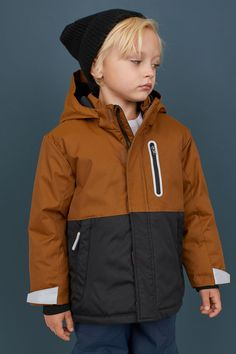 Padded jacket in windproof, water-repellent functional fabric with a lined, detachable hood. Stand-up collar, zipper at front with chin guard, and wind flap Wind Jacket, Waterproof Coat, Kids Coats, Brown Jacket, Black Kids, Padded Jacket, Fashion Company, Kids Wear, Boy Fashion