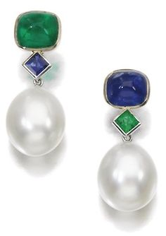 Gem set and cultured pearl earrings. Each suspends a cultured pearl drop from a surmount set with emeralds and sapphires. Via Sotheby's.