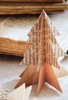 DIY Christmas tree ornament - card cutouts of a tree, apply newspaper, music print or old book pages and voila! Rustic, simple, elegant. (pinned via Mette Tjerbo Heines)