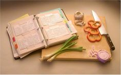 Extremely realistic carving of a cookbook, cutting board, vegetables, and knife  (8 pics).