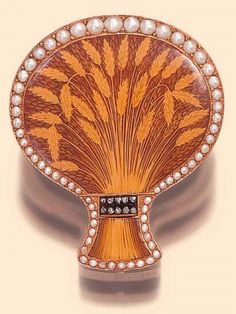The Wheat Sheaf. Geneva, circa 1820. Very fine 18K gold and painted on enamel, pearl- and diamond-set vinaigrette, designed as a sheaf of wheat.