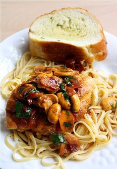 Chicken Marsala ~  The ingredients are as basic and inexpensive as they come, from the crispy bacon to the tender mushrooms and fresh parsley, but together, they guarantee a flavor that is absolutely incomparable. Once you create a smooth, rich sauce from the butter, Marsala wine, and all that irresistible flavor from the cooked bacon, you pour it over the tender pan-roasted chicken breast, lay it on a bed of warm pasta