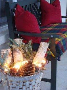 basket or tin of pinecones and logs with lights for the fireplace
