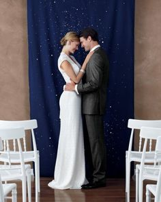 To craft a ceremony marker that's out of this world, lay a dark blue length of cloth on a protected surface, and, like you're wielding a marker, (dis)color on dots with a Clorox gel bleach pen.