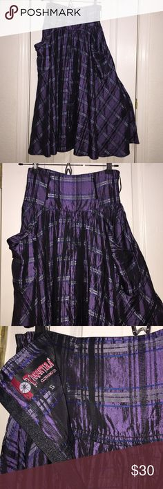 "⚡️SALE PINUP SKIRT NWOT Beautiful purple plaid empire waisted skirt by TARANTULA CLOTHING CO, Made in the USA! Size SMALL waist measures at 13"" across with elastic pieces at both side for a little bit of give. Measures at 32"" long, midi length. Feel free to ask questions. NEVER WORN, washed. Tarantula Skirts A-Line or Full"