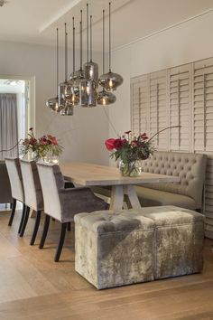 Interiors DMF Dining Lyon bank met dining chair Marseille & Louvre poefjes. Lights by Eve