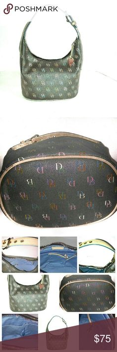 Authentic Dooney & Bourke Purse Authentic Dooney & Bourke Small Purse. Black with a film over it so it will look gray but in pics you can see it's black. Has signature in pastel colors all-around bag. has an adjustable strap that can be adjusted to your liking by simply putting it in another hole just like a belt. has zipper pouch inside purse and two pockets for cell phone's or other stuff. inside lining is a beautiful blue. Nothing is wrong with it just couldn't use it because I carry too…