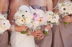 There is also gerber daisys in the bridesmaids bouquets- but no this kind with dark center, it's a pale pale pink kind with a light yellow center