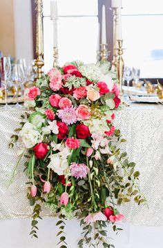 cascading floral table runner - photo by Debbie Lourens Photography http://ruffledblog.com/smitten-with-sparkle-wedding-inspiration #tablescapes