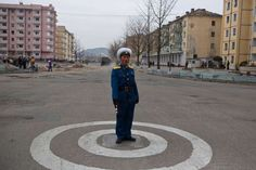 A North Korean traffic policeman stands at an intersection in Kaesong, North Korea on April 23.