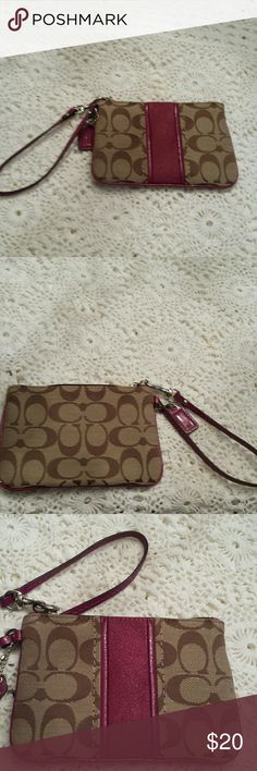 Super cute! Pink and beige wristlet Cute pink and beige wristlet -  coach logo not real Great condition Bags Clutches & Wristlets