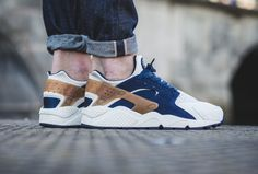 sale retailer 5e2bc 30a44 The Nike Air Huarache in midnight navy ale brown is showcased in lifestyle  imagery.