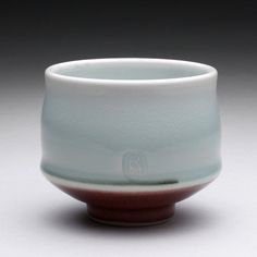 Ray Morales | porcelain (turquoise celadon with red base) wheel-thrown yunomi.