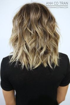 Back view of layered balayage lob hairstyle for thick hair