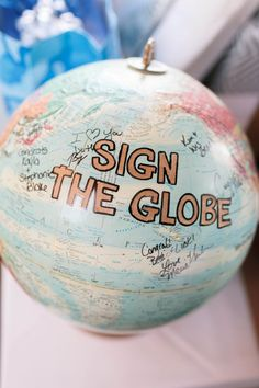Pink & Orange Vintage Travel Themed Wedding - sign the globe where you've travelled from .