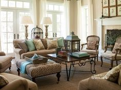 Robin egg blue and brown living room. The pattern mixing in this space is great! Just enough to keep it interesting, but not overwhelming.