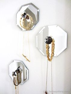 One of the best ideas I've seen thus far! A knob glued to a dollar store mirror = instant jewelry organizer!