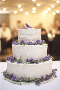 3-tier white stucco smear frosting purple wild flowers