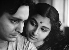 Soumitra Chatterjee as Apu (left) and Sharmila Tagore (right) as Aparna.