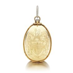 GOLD AND DIAMOND NÉCESSAIRE DU SOIR, CARTIER, PARIS, December 1947. Egg shaped with twisted ropework borders, the front engraved with the armorial bearings of His Royal Highness The Duke of Windsor, the reverse with a monogram of the initials WW for Wallis Windsor below a Royal Ducal coronet, the thumbpiece collet-set with a rose diamond, suspended from a pendant ring accented with single-cut diamonds, opening to reveal a single lidded compartment with a mirror and feather powder puff.