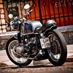 This slammed custom BMW motorcycle is a 1977 R80/7 built by Luka Cimolini in his garage in Ljubljana, Slovenia.
