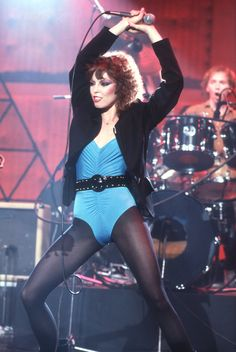 "Pat Benatar's songs include: ""Love is a Battlefield"" ""We Belong"" ""Fire and Ice"" ""Hit me with your best shot"" ""All Fired Up"" ""Promises in the Dark"""