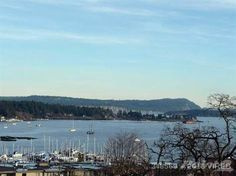 View from the balcony over the boats at the yacht club towards Newcastle Island Harbour City One 220 Townsite Road, Nanaimo, British Columbia