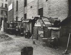 Huts and unemployed, West Houston and Mercer St., Manhattan.  Abbott, Berenice -- Photographer. October 25, 1935