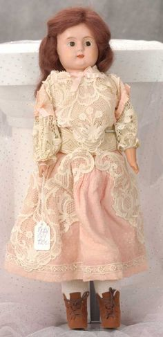 Antique  Doll with a beautiful lace overlay dress
