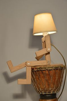 Wooden design lamp in the form of a little personage with