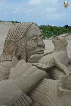 """Broken Wing""... Fred Mallett's sand sculpture of a Native American man helping a bird"