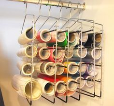 Organizing craft vinyl rolls with pants hangers. Vinyl Storage, Craft Room Storage, Craft Organization, Craft Rooms, Storage Ideas, Organizing Crafts, Scrapbook Organization, Silhouette Projects, Silhouette Vinyl