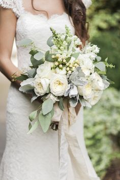 Bouquet by LSL Event Design with ribbon from Froufrou Chic. Lace #wedding dress by Sareh Nouri from White Dresses in Huntsville, AL. Image by Leslie Hollingsworth. #bride #bridal