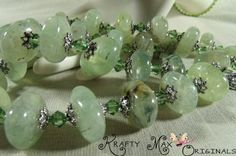 NATURAL SMOOTH PERIDOT STONES AND SWAROVSKI CRYSTAL 3 PIECE SET by Krafty Max Originals http://www.lajuliet.com/index.php/2013-01-04-15-21-51/ad/strand,45/natural-smooth-peridot-stones-and-swarovski-crystal-3-piece-set,90