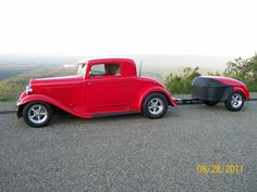 Our 1932 Plymouth PB coupe with rumble seat and Champion trailer in the mountains @ Mena, Arkansas