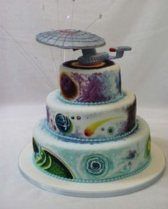 I found it: the Star Trek Wedding Cake! With a few modifications, this is similar to the design I had in mind: the Star Trek Enterprise elevated on top of 3 or more round tiers. Bolo Star Trek, Star Trek Cake, Star Trek Party, Star Wars, Star Trek Humor, Beautiful Cakes, Amazing Cakes, Star Trek Birthday, Star Trek Wedding