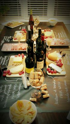 """wine & cheese party- black paper and write on it with white, silver or gold marker to label everything."" It would be so cool to do this with chalkboard paint on the table's surface too!"