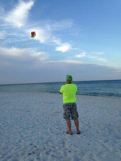 Flying a kite at Cape San Blas, Florida.