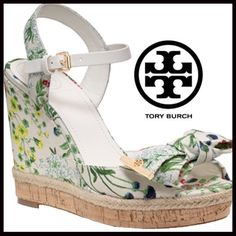 """Tory Burch Floral Wedge Tory Burch Floral Wedge A jute-skimmed cork platform adds earthy allure to a playful mixed-media wedge accented with signature gilt hardware. 4 1/4"""" heel; 1"""" platform (size 8.5). Adjustable strap with buckle closure. Leather and textile upper/leather lining and sole. By Tory Burch; imported. Tory Burch Shoes Wedges"""