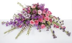 A lovely feminine casket spray www.picketfenceflowersandgifts.com can create this beautiful casket spray.