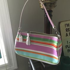 NEW Coach  canvas& leather bag W removable strap Brand New (I used to work for Coach) adorable white leather and multi colored canvas small bag. Strap is detachable on one side. Inside has one zipper pocket. Perfect for anything Summer! ;) Coach Bags Mini Bags