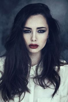 Dark red lips, dark eyes and messy beautiful long hair. Style inspiration.