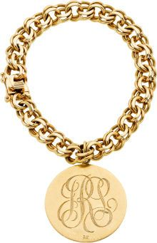 The bracelet suspends one monogrammed charm, both in 14k gold.