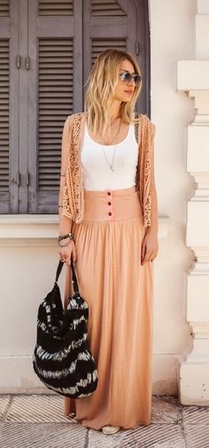 Lemonette raspberrily pouting in black shades, salmon cardigan & high-waisted skirt, white camisole