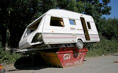 Trailer trash: A waste collector was stunned when he went to pick up a skip from a customer in Newport in South Wales - and found they had dumped an entire caravan on top of it. Tyrone Covell, 43, admitted he