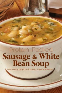With Italian-style chicken sausage tons of veggies beans and escarole this protein-packed soup is sure to make your belly warm full and happy. Substitute escarole with any leafy green of your choice if you prefer. Healthy Food Recipes, Healthy Soup, Cooking Recipes, Dinner Healthy, White Bean Sausage Soup, White Bean Soup, White Beans, Italian Sausage Soup, Sauce Pizza