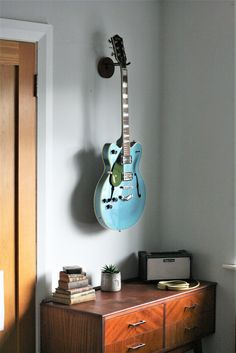 Spring Cleaning and organising your home? Looking for a beautiful handmade house warming gift? Things For Strings makes solid wooden holders for ukuleles, guitars, mandolins and banjos. #housewarming #springclean #organiseyourhome #homedecor #musicroom #ukulele #guitar #wallhanging #wallmount #hanger #handmade #giftsforhim #giftsforher #music #guitarhanger #hook #woodhanger #wallart #storageideas #handmadeinireland #guitarwallmount #ukulelewallmount #uke Ukulele Wall Mount, Guitar Wall Hanger, Organizing Your Home, Organising, Handmade House, Banjos, Home Look, Spring Cleaning, Guitars