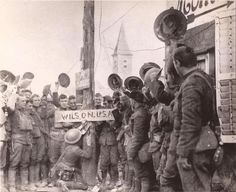 """In this photo, American troops change a German street sign in a town in the St Mihiel salient on the Western Front in September 1917: """"'Hindenburgstrasse' is renamed 'Wilson USA"""